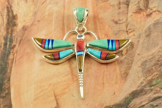 "Beautiful Dragonfly Pendant featuring Genuine Turquoise, Spiny Oyster Shell, Tiger's Eye and Blue Lapis inlaid in Sterling Silver.  Free 18"" Sterling Silver Chain with Purchase of Pendant. Designed by Navajo Artist Calvin Begay. Signed by the artist."