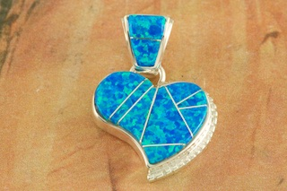 "Stunning Heart Pendant featuring Fire and Ice Lab Opals inlaid between ribbons of Sterling Silver. Free 18"" Sterling Silver Chain with Purchase of Pendant. Designed by Navajo Artist Calvin Begay. Signed by the artist."