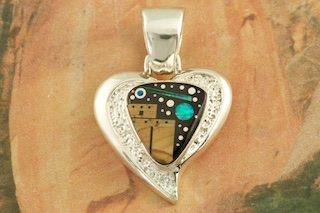 "Starry Night in the Pueblo with a Beautiful Shooting Star. Genuine Picture Jasper and Acoma Jet inlaid in Sterling Silver. Free 18"" Sterling Silver Chain with Purchase of Pendant. Stunning Heart Pendant Designed by Navajo Artist Calvin Begay. Signed by the artist."