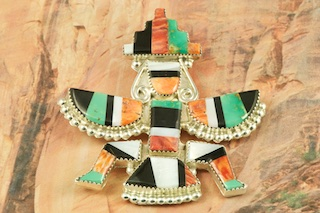 """Stunning Knifewing Kachina Pin/ Pendant featuring Genuine Turquoise, Mother of Pearl, Jet and Spiny Oyster Shell inlaid in Sterling Silver. Created by Zuni Artist Eldred Martinez. Signed by the artist.  Free 18"""" Sterling Silver Chain with Purchase of Pendant. The Zuni Pueblo is located in New Mexico, Land of Enchantment."""