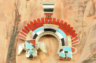 "Zuni Indian Sterling Silver Rainbow Man Pendant featuring Genuine Turquoise, Red Coral, Jet, Gold Lip and White Mother of Pearl. Created by Zuni Artist Fadrian Bowannie. Signed by the artist. Free 18"" Sterling Silver Chain with Purchase of Pendant. The Zuni Pueblo is located in New Mexico, Land of Enchantment."