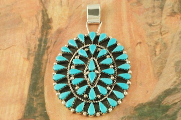 """Genuine Sleeping Beauty Turquoise set in Sterling Silver Pendant. Created by Zuni Artist Veronica Martza. Signed by the artist. The Zuni Pueblo is located in New Mexico, Land of Enchantment. Free 18"""" Sterling Silver Chain with Purchase of Pendant."""