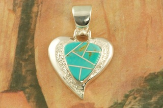 "Beautiful Heart Pendant featuring Genuine Turquoise  inlaid between ribbons of  Sterling Silver. Free 18"" Sterling Silver Chain with Purchase of Pendant. Designed by Navajo Artist Calvin Begay. Signed by the artist."