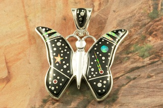 "Stunning Butterfly Starry Night Design featuring Genuine Black Jade inlaid in Sterling Silver. Beautiful Fire and Ice Lab Opal Moon and Shooting Star! Free 18"" Sterling Silver Chain with Purchase of Pendant. Designed by Navajo Artist Calvin Begay. Signed by the artist."