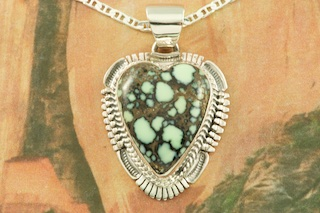Genuine Nevada Variscite set in Sterling Silver Heart Pendant. Created by Navajo Artist Bennie Ration. Signed by the artist. Free 18 inch Sterling Silver Chain with purchase of pendant. The Nevada Variscite Mine is located in Lander County, Nevada.