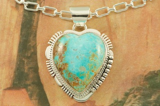 "Stunning Sterling Silver Heart Pendant featuring Genuine Easter Blue Turquoise. Created by Navajo Artist John Nelson. Signed by the artist. Free 18"" Sterling Silver Chain with purchase of pendant. The Easter Blue mine is located northwest of Tonopah, Nevada a few miles from the Royston district. Turquoise from this claim has also been called Blue Mountain and Blue Gem. It was discovered in 1907 and the first material found was a fine blue color, usually occurring in thin veins, later the mine produced a blue green turquoise with a light to dark brown matrix."