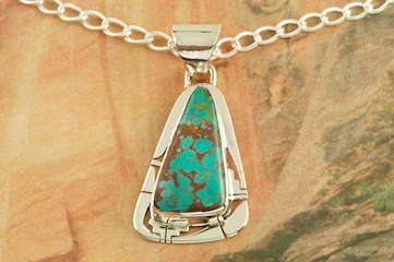 "Genuine Sierra Nevada Turquoise set in Sterling Silver Pendant. Free 18"" Sterling Silver Chain with Purchase of Pendant. Created by Navajo Artist Phillip Sanchez. Signed by the artist."