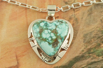 "Genuine Sierra Nevada Turquoise set in Sterling Silver Heart Pendant. Free 18"" Sterling Silver Chain with Purchase of Pendant. Created by Navajo Artist Phillip Sanchez. Signed by the artist."