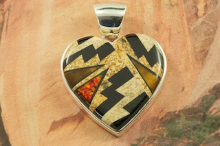 "Beautiful Heart Pendant featuring Genuine Picture Jasper, Tiger's Eye and Black Jade inlaid in Sterling Silver. Fire and Ice Lab Opal Accents. Free 18"" Sterling Silver Chain with Purchase of Pendant. Designed by Navajo Artist Calvin Begay. Signed by the artist."