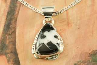 "Beautiful Pendant featuring Genuine White Lightning set in Sterling Silver. Free 18"" Sterling Silver Chain. White Lightning Stones are a stunning new discovery from the hills of Tonopah, Nevada. Created by Navajo Artist Hebert Pino. Signed by the artist."