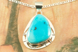 Sterling Silver Pendant featuring Genuine Sleeping Beauty Turquoise. Created by Navajo Artist Phillip Sanchez. Signed by the artist. Free 18 inch Sterling Silver Chain with purchase of pendant. The Sleeping Beauty Turquoise Mine is located in Gila County, Arizona. The mine is recently closed and the turquoise stones are obtained from private collections.