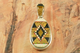 "Genuine Picture Jasper, Tiger's Eye and Black Jade inlaid in Sterling Silver. Stunning Fire and Ice Lab Opal Accents. The Reverse Side features a Contemporary Sterling Silver Corn and Kachina Design. Free 18"" Sterling Silver Chain with Purchase of Pendant.  Pendant Designed by Navajo Artist Calvin Begay. Signed by the artist."
