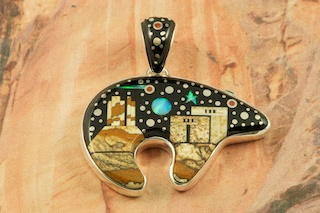 "This Pendant is a work of art! Beautiful Starry Night at the Pueblo with a View of Monument Valley. Featuring Picture Jasper, and Black Jade inlaid in Sterling Silver Pendant. Beautiful Fire and Ice Lab Opal Moon and Shooting Star! The reverse side of the Bear Pendant has a Beautiful Sterling Silver Pueblo Design with Moon and Stars. Free! 18"" Sterling Silver Chain with purchase of Pendant. Designed by Navajo Artist Calvin Begay. Signed by the artist."