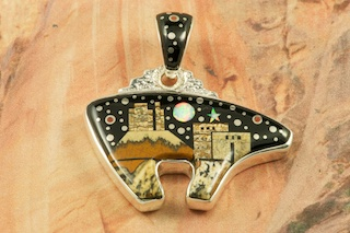 "This Pendant is a work of art! Beautiful Starry Night at the Pueblo with a View of Monument Valley. Featuring Picture Jasper, and Black Jade inlaid in Sterling Silver Pendant. Beautiful Fire and Ice Lab Opal Moon and Star! The reverse side of the Bear Pendant has a Beautiful Sterling Silver Heart Line Design. Free! 18"" Sterling Silver Chain with purchase of Pendant. Designed by Navajo Artist Calvin Begay. Signed by the artist."