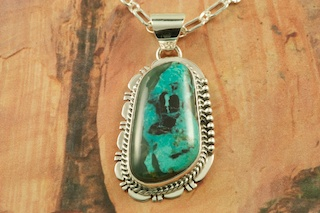 Beautiful Pendant featuring Genuine Blue Diamond Turquoise set in Sterling Silver. Created by Navajo Artist John Nelson. Signed by the artist. Free 18 inch Sterling Silver Chain. The Blue Diamond mine, located in central Nevada, opened in the late 1950�s and was mined up to 1980. This mine is considered a �hat mine� of which there are very few. A hat mine is a small deposit of turquoise that, �you can cover with your hat.� This mine is now closed and buried under thousands of tons of rock.