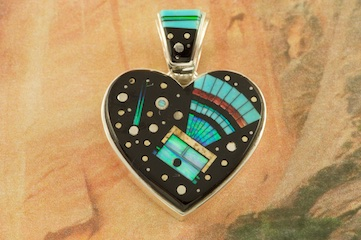 "Beautiful Starry Night Heart Pendant with Mystical Yei.. Genuine Acoma Jet, Turquoise and Spiny Oyster Shell inlaid in Sterling Silver Pendant with Fire and Ice Lab Opal Accents. Free 18"" Sterling Silver Chain with Purchase of Pendant. Designed by Navajo Artist Calvin Begay. Signed by the artist."