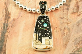 "This Pendant is a work of art! Beautiful Starry Night at the Pueblo with a View of Monument Valley. Featuring Picture Jasper, and Black Jade inlaid in Sterling Silver Pendant. Beautiful Fire and Ice Lab Opal Moon and Shooting Star! The reverse side of the Pendant has a Beautiful Sterling Silver Contempory Design. Free! 18"" Sterling Silver Chain with purchase of Pendant. Designed by Navajo Artist Calvin Begay. Signed by the artist."