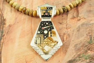 This Pendant is a work of art! Beautiful Starry Night at the Pueblo with a View of Monument Valley. Featuring Picture Jasper, and Black Jade inlaid in Sterling Silver Pendant. Beautiful Fire and Ice Lab Opal Moon and Shooting Star! Genuine Picture Jasper Necklace accented with Genuine Turquoise and Sterling Silver Beads.  Designed by Navajo Artist Calvin Begay. Signed by the artist.