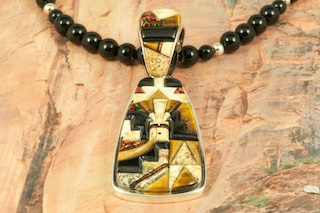 "Genuine Picture Jasper, Tiger's Eye and Black Jade inlaid in Sterling Silver Pendant and Bale. Beautiful Fire and Ice Lab Opal accents. The reverse side of the Pendant has a Sterling Silver Gecko Design. 18"" Genuine Black Onyx Bead Necklace is included. Designed by Navajo Artist Calvin Begay. Signed by the artist."