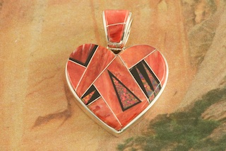"Genuine Spiny Oyster Shell and Acoma Jet inlaid between ribbons of Sterling Silver with Fire and Ice Lab Opal Accents. Free 18"" Sterling Silver Chain with Purchase of Pendant. Designed by Navajo Artist Calvin Begay. Signed by the artist."