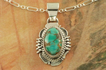 "Genuine Sierra Nevada Turquoise set in Sterling Silver. Free 18"" Sterling Silver Chain with Purchase of Pendant. Created by Navajo Artist Bennie Ration. Signed by the artist."