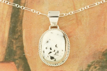 "Genuine White Buffalo Turquoise set in Sterling Silver Pendant. This Beautiful Stone is formed from the minerals Calcite and Iron. It is mined near Tonopah Nevada. Free 18"" Sterling Silver Chain with Purchase of Pendant. Created by Navajo Artist Lyle Piaso. Signed by the artist."