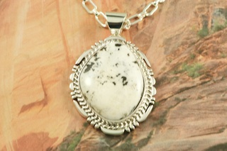 "Genuine White Buffalo Turquoise set in Sterling Silver Pendant. This Beautiful Stone is formed from the minerals Calcite and Iron. It is mined near Tonopah Nevada. Free 18"" Sterling Silver Chain with Purchase of Pendant. Created by Navajo Artist Freddy Charley. Signed by the artist."