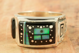 Stunning Starry Night Design by Navajo Artist Calvin Begay. Featuring Genuine Black Jade inlaid in Sterling Silver Ring. Beautiful Fire and Ice Lab Opal Accents. Signed by the artist.
