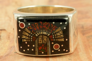 This Ring is a work of art! Beautiful Indian Headress Design in the Starry Night with Red Coral Planets. Featuring Genuine Black Jade and Wild Horse inlaid in Sterling Silver. Stunning Fire and Ice Lab Opal Accents. Designed by Navajo Artist Calvin Begay. Signed by the artist.