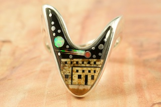 This Ring is a work of art! Beautiful Starry Night in the Pueblo. Featuring Picture Jasper and Black Jade inlaid in Sterling Silver Ring. Beautiful Fire and Ice Lab Opal Moon and Shooting Star! Designed by Navajo Artist Calvin Begay. Signed by the artist.