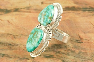 """Genuine Turquoise Mountain Mine Stone set in Sterling Silver Ring. Created by Navajo Artist Sampson Jake. Signed by the artist.. The Turquoise Mountain Mine is located in the Mineral Park Mining District, Mohave County, Arizona. Although Turquoise Mountain is located near the Kingman Turquoise Mine it is considered a classic mine in its own right because the Turquoise is so different in appearance. It is also known as """"Old Man Turquoise""""."""