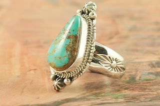 Genuine Royston Turquoise Stone set in Sterling Silver Ring. The Royston Turquoise Mine is located in Nye County, Nevada. Created by Navajo Artist Lucy Valencia. Signed L. J. by the artist.