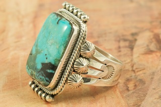 Genuine Blue Diamond Turquoise set in Sterling Silver Ring. Created by Navajo Artist Aaron Toadlena. Signed by the artist. The Blue Diamond Mine, located in central Nevada, opened in the late 1950�s and was mined up to 1980. This mine is considered a �hat mine� of which there are very few. A hat mine is a small deposit of turquoise that, �you can cover with your hat.� This mine is now closed and buried under thousands of tons of rock.