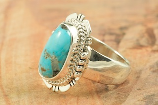 Genuine Sleeping Beauty Turquoise set in Sterling Silver Ring. The Sleeping Beauty Turquoise Mine is located in Gila County, Arizona. The mine is recently closed and the turquoise stones are obtained from private collections. Created by Navajo Artist Sampson Jake. Signed by the artist.