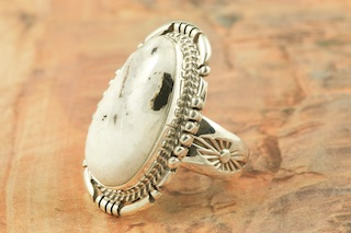 Genuine White Buffalo Turquoise set in Sterling Silver Ring. This Beautiful Stone is formed from the minerals Calcite and Iron. It is mined near Tonopah Nevada. Created by Navajo Artist John Nelson. Signed by the artist.