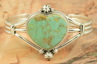 Stunning Heart Bracelet featuring Genuine Crow Springs Turquoise set in heavy gauge Sterling Silver. The Crow Springs Mine is located near Tonopah, Nevada. Created by Navajo Artist Lucy Valencia. Signed L. J. by the artist.