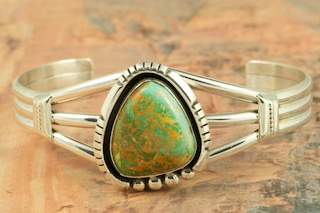 Stunning heavy gauge Sterling Silver Bracelet featuring Genuine Crow Springs Turquoise. The Crow Springs Mine is located near Tonopah, Nevada. Created by Navajo Artist Larson Lee. Signed by the artist.