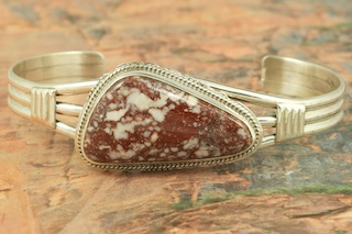"Genuine Wild Horse Stone set in Sterling Silver Bracelet. This stone is also known as ""Crazy Horse"". It is mined near Globe, Arizona. Created by Navajo Artist Larson Lee. Signed by the artist."