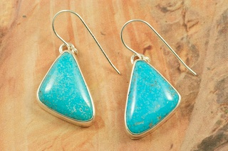 Genuine High Grade Kingman Web Turquoise set in Sterling Silver Earrings. Created by Navajo Artist Tony Garcia. Signed by the artist. The Mineral Park Mine, in the Cerbat Mountains 14 miles northwest of Kingman, was first mined by Indians centuries before white man came to the area. It is one of the three sites of prehistoric mining localities in the state of Arizona. Mineral Park was the most extensively worked area by the Indians of the three. S.A. �Chuck� Colbaugh found a cache of stone hammers uncovered in ancient trenches and tunnels, when he had the turquoise mining concession in May of 1962. Ithaca Peak and Turquoise Mine (formally called Aztec Mountain or Aztec Peak) are the most famous of the peaks in the area containing turquoise.
