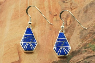 Genuine Blue Lapis inlaid between ribbons of Sterling Silver. French Wire Earrings feature precision channel inlay. Designed by Navajo Artist Calvin Begay. Signed by the artist.