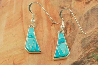 Genuine Sleeping Beauty Turquoise inlaid between ribbons of Sterling Silver. Beautiful French Wire Earrings Designed by Navajo Artist Calvin Begay. Signed by the artist.