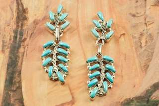 Genuine Sleeping Beauty Turquoise set in Sterling Silver Post Earrings. Beautiful Petit Point Design. The Sleeping Beauty Turquoise mine is located in Gila County, Arizona. Created by Zuni Artist Alrick Waikaniwa. The Zuni Pueblo is located in New Mexico, Land of Enchantment.