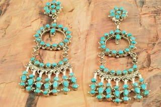 Genuine Sleeping Beauty Turquoise set in Sterling Silver Post Earrings. Beautiful Petit Point Design. The Sleeping Beauty Turquoise mine is located in Gila County, Arizona. Created by Zuni Artist Phyllis Laate. The Zuni Pueblo is located in New Mexico, Land of Enchantment.