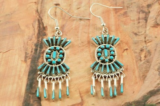 "Genuine Sleeping Beauty Turquoise set in Sterling Silver French Wire Earrings. Beautiful Needle Point Design. The Sleeping Beauty Turquoise Mine is located in Gila County, Arizona. Free 18"" Sterling Silver Chain with Purchase of Pendant. Created by Zuni Artist Shirley Lahi. Signed by the artist. The Zuni Pueblo is located in New Mexico, Land of Enchantment."