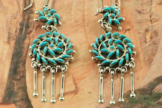 Stunning Earrings featuring Genuine Sleeping Beauty Turquoise set in Sterling Silver. Beautiful Petit Point Design. Many days of painstaking work went into creating this Southwestern Art Masterpiece. Created by Master Zuni Artists Octavious and Irma Seowtewa. Signed by the artists.  The Zuni Pueblo is located in New Mexico, Land of Enchantment.