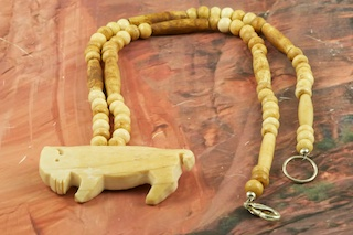 """Stunning Necklace featuring hand carved Moose Bone Bison, Buffalo Bone Hairpipe and Beads. Sterling Silver Beads and Clasp. Created by Mi' Kmaq Artist Don """"Standing Bear"""" Forest. Don """"Standing Bear"""" was born in Massachusetts, the son of Andre """"Grey Wolf"""" Forest and Esther """"NightDancer"""" Forest. In 1975, Don followed his dream and moved to Alaska. When Don is not busy with his art he teaches traditional Native American Drumming and Dancing to elementary students, as well as Native arts and crafts."""