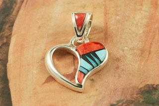 "Beautiful Heart Pendant featuring Genuine Spiny Oyster Shell, Turquoise and Blue Lapis inlaid in Sterling Silver. Accents of Fire and Ice Lab Opals. Free 18"" Sterling Silver Chain with Purchase of Pendant. Designed by Navajo Artist Calvin Begay. Signed by the artist."