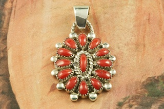 "Beautiful Petit Point Design with Genuine Red Coral set in Sterling Silver Pendant. Created by Zuni Artist Lorraine Waatsa. Signed by the artist. The Zuni Pueblo is located in New Mexico, Land of Enchantment. Free 18"" Sterling Silver Chain with Purchase of Pendant."