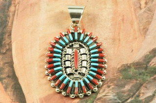 "Stunning Needle Point Pendant featuring Genuine Sleeping Beauty Turquoise and Red Coral set in Sterling Silver. The Sleeping Beauty Turquoise Mine is located in Gila County, Arizona. Free 18"" Sterling Silver Chain with Purchase of Pendant. Created by Zuni Artist Carla Laconsello. Signed by the artist. The Zuni Pueblo is located in New Mexico, Land of Enchantment."
