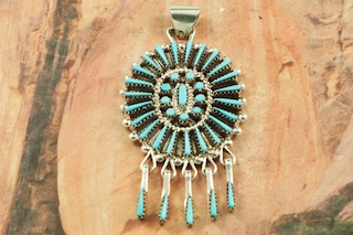 "Genuine Sleeping Beauty Turquoise set in Sterling Silver Pendant. Beautiful Neddle Point Design. The Sleeping Beauty Turquoise Mine is located in Gila County, Arizona. Free 18"" Sterling Silver Chain with Purchase of Pendant. Created by Zuni Artist Shirley Lahi. Signed by the artist. The Zuni Pueblo is located in New Mexico, Land of Enchantment."
